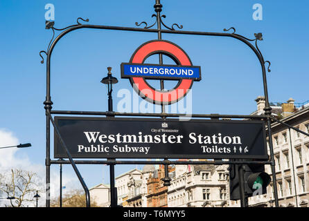 The London Underground sign for Westminster Station in London, England. - Stock Photo
