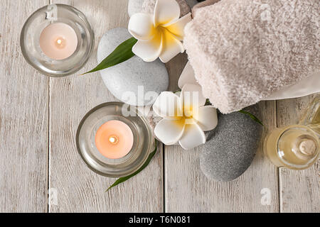 Set for spa treatment on wooden background - Stock Photo