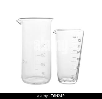 Glass beakers on white background - Stock Photo