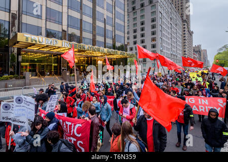 New York, United States. 01st May, 2019. Hundreds of New Yorkers gathered in front of the Trump International Hotel and Tower at Columbus Circle in celebration of May Day - an occasion often synonymous with fighting for workers' rights - in support of issues ranging from fair wages for restaurant workers, to lower tuition costs, to fighting against Trump's proposed border wall. Credit: Erik McGregor/Pacific Press/Alamy Live News - Stock Photo
