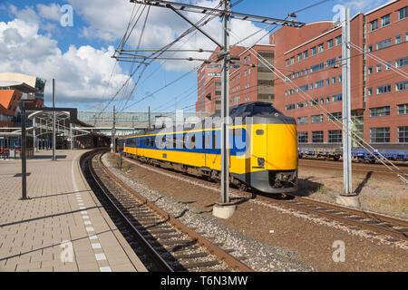 Train leaving Dutch station of Amersfoort - Stock Photo