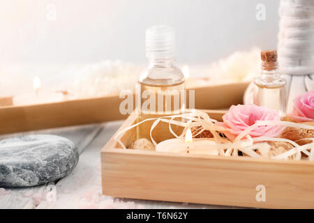 Spa composition with candles and flowers on wooden table - Stock Photo