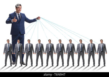 The boss employee manipulating his staff in business concept - Stock Photo