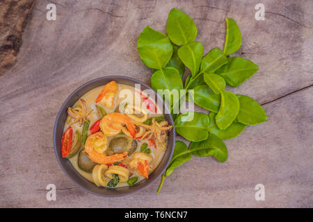 Thai food chicken green curry on dark wooden background. top view - Stock Photo