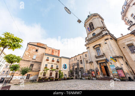 Lviv, Ukraine - August 1, 2018: Dominican church cathedral exterior in historic Ukrainian Polish Lvov city during day on cobblestone street - Stock Photo