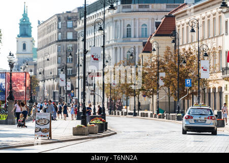 Warsaw, Poland - August 23, 2018: Old town historic street buildings in city during sunny summer day Krakowskie Przedmiescie and architecture - Stock Photo