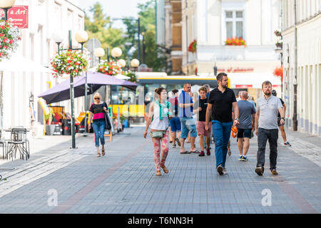 Warsaw, Poland - August 23, 2018: Old town cobblestone street people tourists walking on summer day cobbled road - Stock Photo