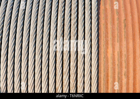 Detail of a big winch winding a steel cable - Stock Photo