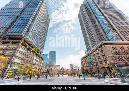 Tokyo, Japan - April 1, 2019: Main Station building view in downtown with skyscrapers modern cityscape skyline