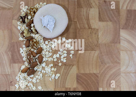 Freshly made oat, almond and walnut face scrub. Farm to face concept, vegan and cruelty free lifestyle. - Stock Photo