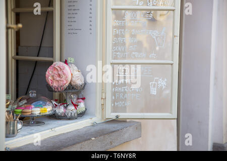 City Prague, Czech Republic. Outdoor cafe, cakes on the window and choice. April 24. 2019 Travel photo. - Stock Photo