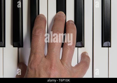 Top View of Piano Keyboard and Hand. Playing Piano. Close Up, Music Instrument, Concept - Stock Photo