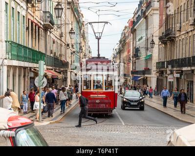 Hills Tramcar tour Lisbon, Red Tram on a busy street in Lisbon, Portugal, Travel destination - Stock Photo