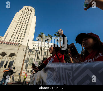 Los Angeles, USA. 1st May, 2019. People attend an annual march for International Labor Day in Los Angeles, the United States, on May 1, 2019. Credit: Zhao Hanrong/Xinhua/Alamy Live News - Stock Photo