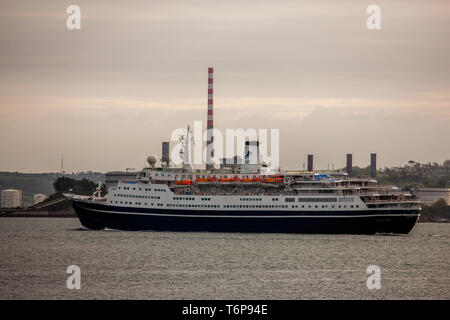 Crosshaven, Cork, Ireland. 02nd May, 2019. On her way to visit the historic town of Cobh cruise ship Marco Polo steams past the oil refinery in Whitegate and the ESB generating station in Aghada, Co. Cork, Ireland. Credit: David Creedon/Alamy Live News - Stock Photo