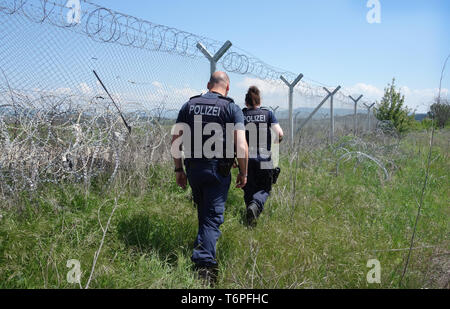 02 May 2019, Greece, Thessaloniki: The North Rhine-Westphalian police officers Muna Mougawaz and Alexander Rankovic are working for the EU border protection organisation Frontex at the border fence between Greece and North Macedonia. North Rhine-Westphalia's Interior Minister Reul visited North Rhine-Westphalian police officers who, as part of the EU border protection agency Frontex, are helping to secure the Greek border with northern Macedonia. The main aim of the officials is to prevent refugees and migrants from illegally arriving in Central Europe from Northern Macedonia. Photo: Alexia An - Stock Photo