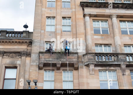 Glasgow, Scotland, UK. 2nd May, 2019. UK Weather. Abseiling window cleaners at work on a warm day with sunny intervals in George Square. Credit: Skully/Alamy Live News - Stock Photo