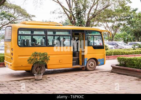 Ton Pheung district, Laos - 13 January 2018, Yellow Laos bus waiting for passengers at Golden triangle special economic zone. - Stock Photo