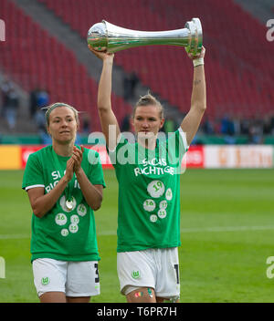 Cologne, Germany May1 2019, women football cup final, VFL Wolfsburg vs SC Freiburg: Zsanett Jakabfi (Wolfsburg), Alexandra Popp (Wolfsburg) lifts the  - Stock Photo