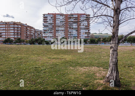 Residential building over Manzanares river in Madrid, Spain, view from Madrid Rio park - Stock Photo