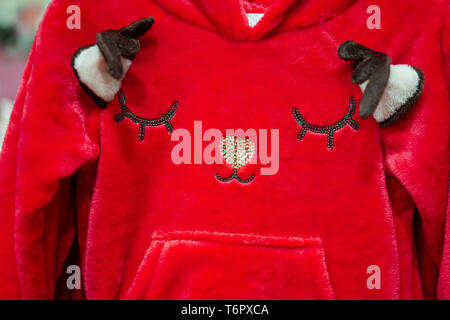 Red reindeer face on kids clothes. - Stock Photo
