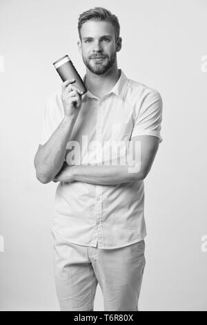 Effective shampoo. Try this shampoo. Best shampoo for your hair type. Make hair stronger and more resilient. Man handsome bearded hipster hold plastic bottle shampoo or shower gel. Hair care concept. - Stock Photo