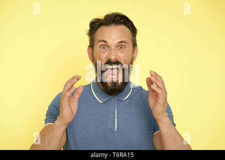 Overwhelmed with emotions. Handsome shouting mature man screaming standing against yellow background. Man bearded irritated annoyed can not keep calm anymore. Stop annoying him. Stressful adult life. - Stock Photo