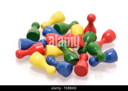 A heap of colorful wooden game figures isolated on white background. Gaming toys, society and teamwork concept.