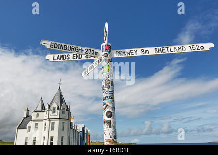 JOHN O'GROAT'S, SCOTLAND - AUGUST 08 2017: Britains lands end sign at john o'groats in scotland with blue skies and ocean and grass in background. Has - Stock Photo