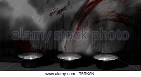 Three small candles in candle holders standing in a row in front of a red color splashed wall. Black and white photo with red color splash. - Stock Photo