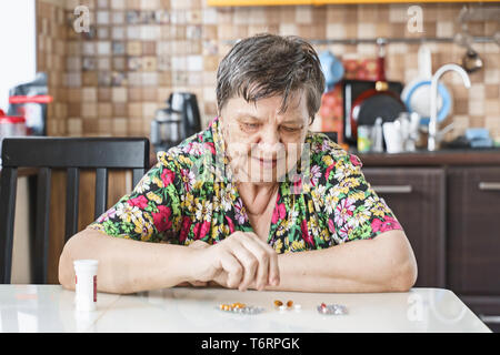 Grandmother, pill, health and the concept of a healthy lifestyle - an old woman takes pills, close-up - Stock Photo