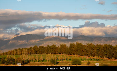 Sunset over the hills near Babylonstoren, Franschhoek, Wine Route South Africa - Stock Photo