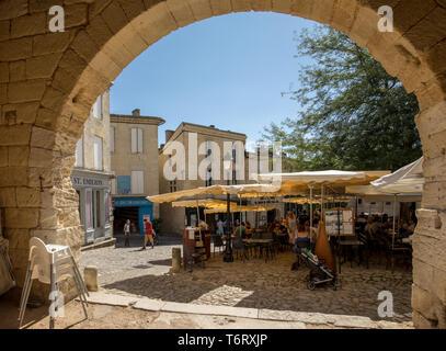 St Emilion, France - September 8, 2018: Place de lEglise Monolithe in St Emilion, Gironde Department, France. St Emilion is French village famous for  - Stock Photo