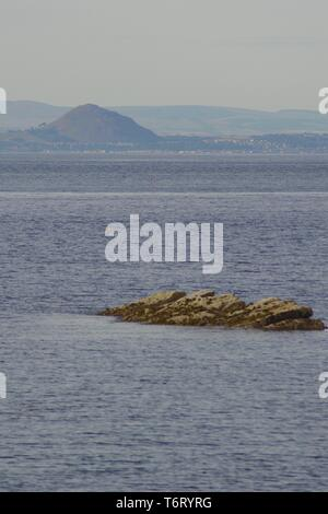 North Berwick Law beyond the Firth of Forth from Crail. Fife, Scotland, UK. - Stock Photo