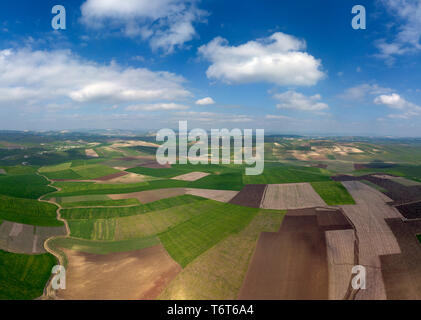 Aerial view of hilly agricultural fields - Stock Photo