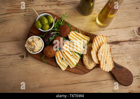 Falafel and Halloumi platter on wood table