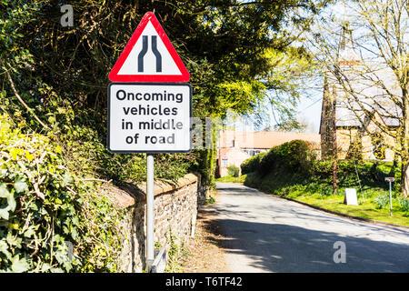 Oncoming vehicles road sign, Oncoming vehicles in middle of road sign, UK road sign, UK road signs, warning, sign, signs, UK, road narrows sign, - Stock Photo