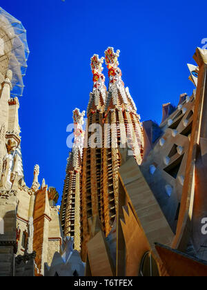 Barcelona, Spain, April 2019: detail of the towers of the famous Sagrada Familia church in Barcelona designed by architect Antoni Gaudí - Stock Photo
