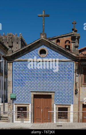 Traditional blue and white tiled chapel in Porto, Portugal - Stock Photo