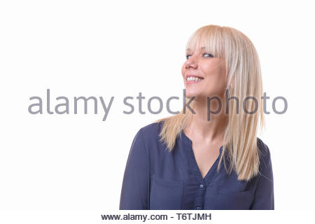Smiling blond woman with her head turned away - Stock Photo