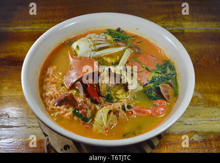 boiled instant noodle with flower crab curry on bowl - Stock Photo