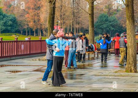 SHANGHAI, CHINA, DECEMBER - 2018 - Group of people dancing at park at shanghai city, china - Stock Photo