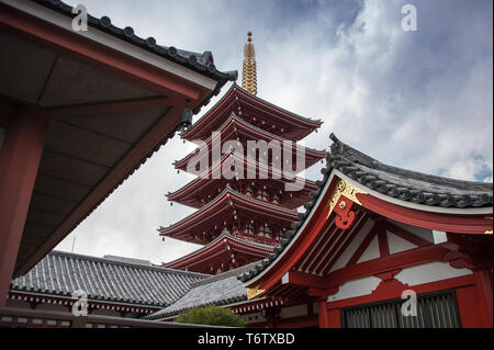 Senso-ji Temple, Tokyo, Japan with moody cloud sky background - Stock Photo