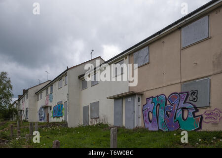 Boarded-up and defaced derelict council houses in Gildas Avenue in the Kings Norton suburb of Birmingham, UK - Stock Photo