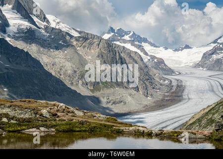 View from Tällisee of the great Aletsch Glacier. In 2018 this and other glaciers in Switzerland lost 2.5 percent of their volume. - Stock Photo