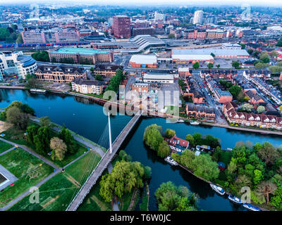 Aerial photograph of Reading, Berkshire, UK, taken at sunrise, including the River Thames. Showing Christchurch Bridge and Reading Station - Stock Photo