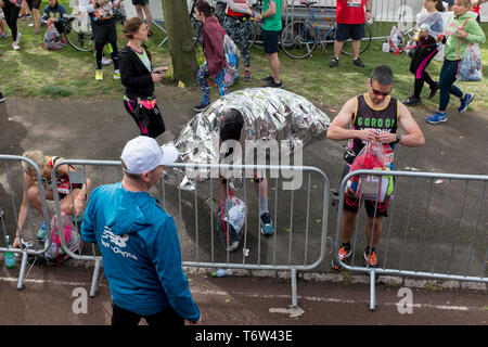 Local London park run volunteers load runners' bags into the lorries in Greenwich Park before the start of the 2019 London Marathon, on 28th April 2019, in London, England - Stock Photo