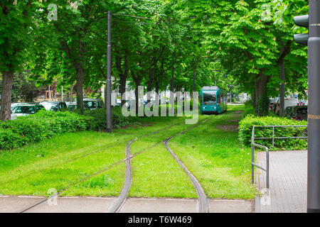 Frankfurt am Main, Germany. April 28, 2019. Hamburger Allee. tram line along the green alley. - Stock Photo