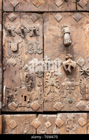 Heavily decorated old wooden door in Estella or Lizzara, Navarre Spain, detail - Stock Photo