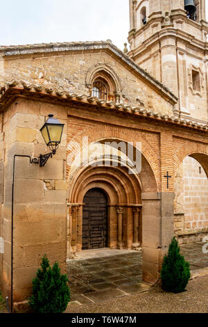 Iglesia de San Andres or Church of San Andres at Villamayor de Monjardin, Navarre, Spain on the Way of St. James or Camino de Santiago, entrance detai - Stock Photo